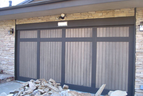 wood panel and vinyl garage door