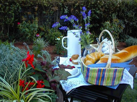 Container Garden as a centerpiece for outdoor dining arrangement for HGTV makeover by Shirley Bovshow