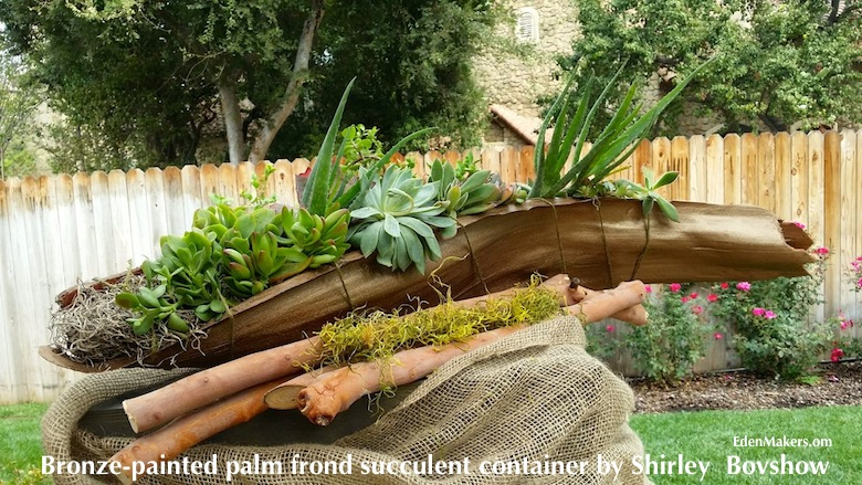 bronze-painted-palm-frond-succulent-container-arrangement-moss-eucalyptus-sticks-designed-by-shirley-bovshow-edenmakers-blog