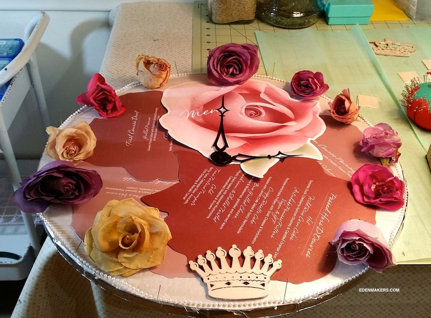 SHIRLEY-BOVSHOW-DRIED-ROSE-CLOCK-FROM-SPECIAL-OCCASION-WITH-CROWN-MEDALLIAN-EDENMAKERS