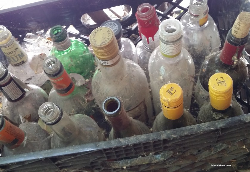 empty-glass-liquor-bottles-in-black-crate-for-garden-crafts-edenmakers-blog