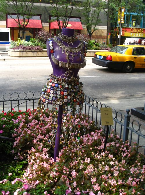 recycled bottle caps used to fashion a dress in chicago street side garden