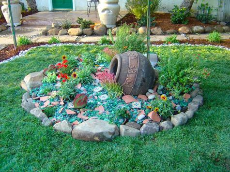 Rock glass and compost tumblers vibrators on pinterest for Garden ideas using recycled materials