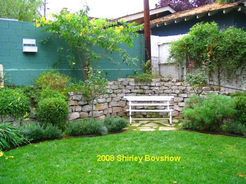 stacked concrete garden wall in country garden